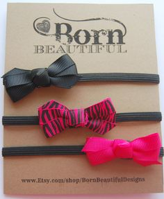 Three Thin Black Newborn Elastic Headbands with Black, Zebra Print, and Bright Pink Bows