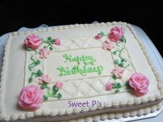 Buttercream sheet cake with lattice piping and buttercream roses