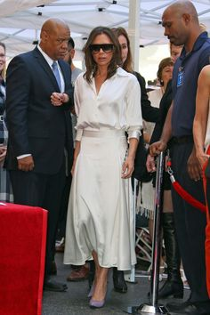 Victoria Beckham Has Something Trailing Down Her Skirt — and It's No Stain, Spill, or Wrinkle