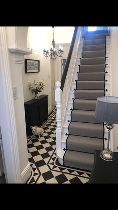 Makeover for our hallway. Had Victorian black and white tiles fitted. Used farrow and ball off black on paint work. Finished off with a grey runner edged in black with black stair rods. Black And White Hallway, Black Stairs, White Staircase, Staircase Runner, Staircase Design, Stair Runners, Stairs With Carpet Runner, Stair Runner Rods, Black Painted Stairs