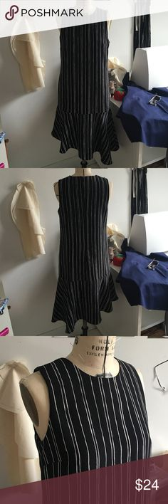 WhoWhatWear by Target Asymmetrical Striped Dress I love this piece. Black and white stripes, super chic, super comfy. Can be worn up with heels or down with a denim jacket and your favorite sneaks! WhoWhatWear Dresses Asymmetrical