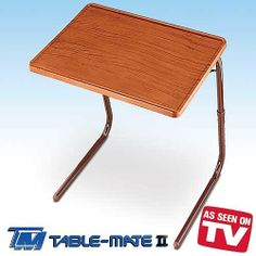 """Table-Mate II Woodgrain Folding Table by Table-Mate. $29.98. Ideal for eating, typing, studying, reading, drawing, and much more. Compact wood-grain folding table for people living in small spaces. Holds up to 50 pounds; surface measures 20 x 15 inches (WxL); distance between the legs is 18.25"""". Folds into compact footprint and stores under sofa or in closet. Tabletop slides to the horizontal position for easy, convenient use. Amazon.com                Ideal for..."""