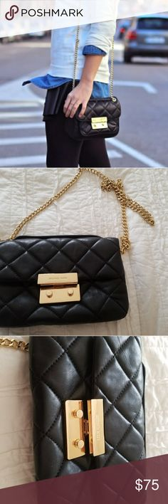 Michael Kors black leather/gold chain shoulder bag MK soft leather gold chain front flap shoulder bag. Dress it up or dress it down. Perfect staple for any style wardrobe. Small wear on buckle Michael Kors Bags Shoulder Bags
