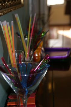 40th birthday: Theme was building future through lens of past.  Throwback to 80's was glow sticks and slow straws.