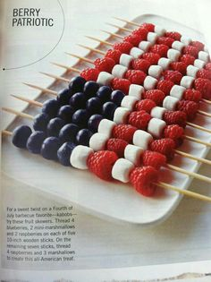 Fruit kabobs with marshmellows on wood skewers.