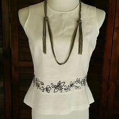 """Another Work Week Chic Pretty and flattering embroidered sleeveless blouse. 17.5"""" across chest lying flat, 20"""" long.  52% Linen, 48% Rayon. Ann Taylor Tops Blouses"""