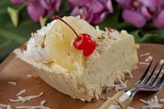 Two-Minute Hawaiian Pie -- this impressive pie is also the easiest pie ever! No-bake filling in a store-bought shortbread crust then garnished with pineapple slices, maraschino cherries, and flaked coconut.