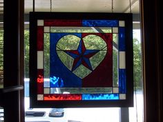 Stained Glass Red, White, and Blue Panel with Texas Star in a Clear Heart at Jitter Beans Mineral Wells, TX