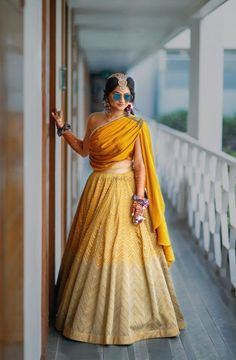 Looking for Indo western mehendi outfit with draped blouse? Browse of latest bridal photos, lehenga & jewelry designs, decor ideas, etc. on WedMeGood Gallery. Indian Fashion Dresses, Indian Gowns Dresses, Indian Designer Outfits, Designer Dresses For Wedding, Shadi Dresses, India Fashion, Fashion Outfits, Indian Wedding Wear, Indian Bridal Outfits