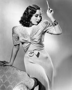 Lupe Velez modeling a two-piece crepe dinner gown with silver beads + sequins | 1940 | #vintage #1940s #fashion