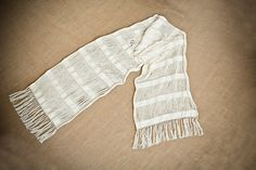 Handwoven Greek shawl Arete with white woven stripes. Its cotton warp is left unwoven at regular intervals giving unexpected shapes when parts of the shawl overlap. It reminds of living creatures such as sea anemones moving in sea water. The shawl is inspired from Queen Aretes costume, which I designed and wove for the theatrical production Odyssey played at Cypria festival. The design is based on drawings from pottery of the 5th century BC depicting the characters of Odyssey. The shawl can…