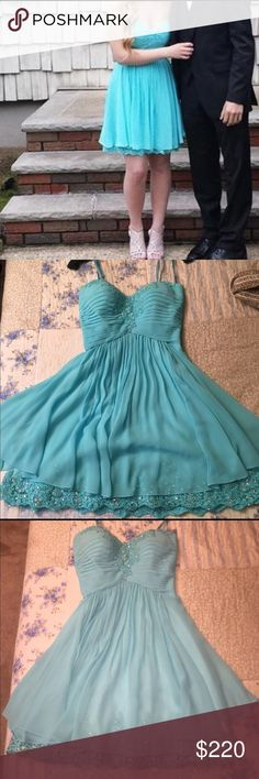 Beautiful strapless La Femme dress This is a beautiful aqua colored short La Femme formal dress.  Lace and beaded detail along the hem and bust.  Length is 27.5 inches long.  Worn once by my daughter for a prom. La Femme Dresses Prom