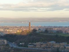 Salisbury Crags and Arthur's Seat cast a long shadow as the low January sun comes up and catches the Nelson Monument on Calton Hill The Forth, Long Shadow, Morning Sun, Athens, Edinburgh, Paris Skyline, City, Building, Travel