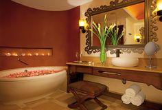Secrets Puerto Los Cabos Golf & Spa Resort Suites come complete with a vanity, bathtub and luxury linens.