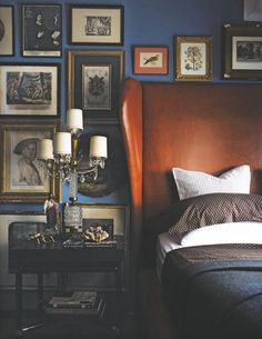 Leather wing-back headboard with Hollywood Regency lamp