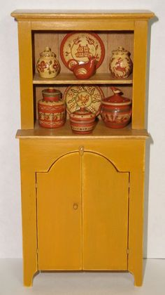 Renee Bowen - Mustard Stepback Tombstone Cupboard; Jane Graber, IGMA arisan - Redware
