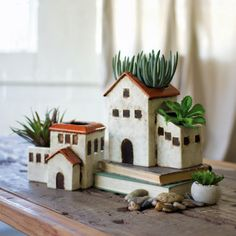 Give your lush ferns and succulents a new home with these ceramic planters featuring classic house designs for traditional charm. Clay Houses, Ceramic Houses, Miniature Houses, Ceramic Planters, Ceramic Clay, Clay Crafts, Diy And Crafts, Pottery Houses, Classic House Design