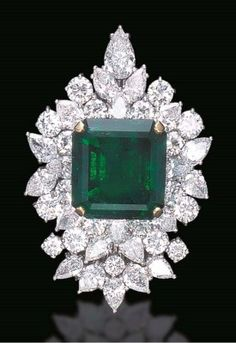 A SPECTACULAR EMERALD AND DIAM
