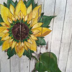 Great idea for a piece of old fence. Paint something on it and put in the yard