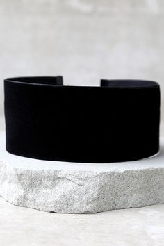 """You'll be the most stylish gal for miles thanks to the Far and Wide Black Velvet Choker Necklace! This wide velvet choker (with gold closures) is a trendy addition to any outfit. Necklace measures 11.5"""" long, plus a 4"""" extender chain."""