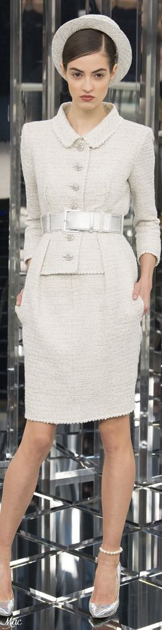 Chanel S-17 Couture: tweed jacket-dress with pockets in seams.