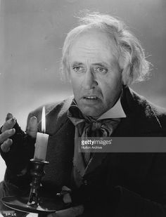 Scottish actor Alastair Sim (1900 - 1976) plays the title role in the film 'Scrooge' (aka 'A Christmas Carol'), directed by Brian Desmond Hurst for Renown.. Edinburgh-born Sim, a former elocution professor, made his stage debut aged 30 and quickly progressed to films in 1935 appearing in five in his first year. He was a character actor who was equally successful in drama and comedy roles. He starred in many films including 'The Belles of St Trinian's' (1954) and 'An Inspector Calls' (1954)…