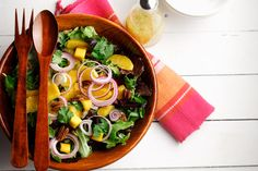CanolaInfo | Recipes & Cooking | Mixed Greens, Mango and Pecan Salad | This festive salad is not only full of color but has delicious healthy ingredients too! |