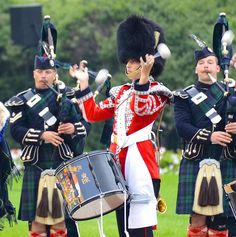 A tenor drummer and pipers from the Governor General's Ceremonial Guard, all reservists of the Canadian Army, perform on Parliament Hill in Ottawa as part of Fortissimo 2012.
