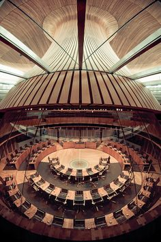 An alternative angle of the interior of the Welsh Assembly building in Cardiff Bay, as seen through the upper floor viewing area with a fish eye lens.