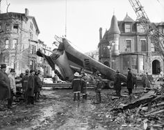 FDNY firefighters operate in the aftermath of an airplane crash at 7th Avenue and Sterling Place, Brooklyn, on Dec. 16, 1960.