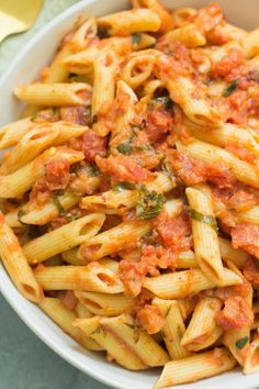 This Vegan Penne Alla Vodka recipe is the perfect easy, healthy dinner! Naturally dairy free, gluten free, nut free and SO creamy. You'd never know this was made without dairy. Easy to make and delicious! #vegan #dairyfree #healthy Healthy Pasta Dishes, Healthy Pastas, Easy Healthy Dinners, Tasty Dishes, Vegan Pasta, Healthy Food, Healthy Eating, Healthy Gluten Free Recipes, Healthy Dinner Recipes