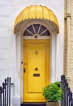 Notting Hill, London, England Matching Yellow awning embraces the front door - very appealing Gate Design, Door Design, Entrance Doors, Doorway, Door Knockers, Door Knobs, Portal, Outdoor Doors, Yellow Doors