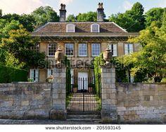 Exterior Wall and Entrance of a Beautiful Georgian Era English Manor - stock photo