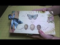 Hi, everyone! I have my Flora & Fauna paper bag album with photos from my trip to a butterfly sanctuary. I have been working on it during my regular Thursday UStream shows. This is a paper bag album designed by Kathy Orta with some modifications by me.  Paper Bag Album Assembly Tutorial: http://www.youtube.com/watch?v=BGRmiFd5MIU  Album P...