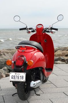 """Red Honda Motor Scooter similar to the one I rode in Indo. It was called a """"Bebek""""."""
