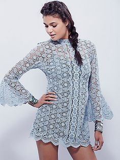 Mock Neck Lace Tunic | Floral crochet tunic featuring a mock neck with a statement flared cuff.  Open back with button closures at back neck.