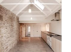 Cotswolds Renovation - Feilden Fowles Architects Contemporary Architecture Design Farm House Kitchen Greenbelt Stone Concrete Floor Oak Panelling Steel Truss Sliding Doors Range AGA View Countryside Extension UK England Rural