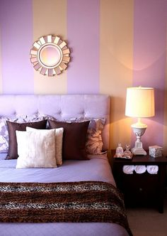 Purple Bedroom Design With Orange Wall Color Combination And Small Bedside Table Using Lamp | NYTexas