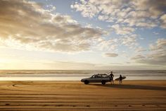 Golden sands and rolling surf make New Zealand's Ninety Mile Beach an irresistible spot to surf until sundown. Image by Amos Chapple / Lonely Planet Images / Getty Images