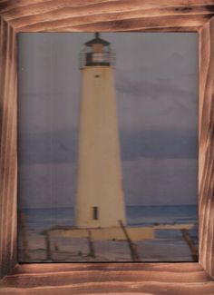 Lighthouse on a sandy beach with free shipping by OldTimeCountryCrafts, $9.50