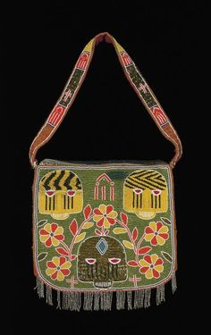 Africa | Diviner's bag.  Yoruba peoples, Nigeria | Mid 20th century | Cloth, glass beads, plant fiber | Yoruba consider only the gods or those who communicate with them to be entitled to own and display fully beaded objects, such as this diviner's bag. Diviners, like rulers, mediate forces in the spiritual realm. Sacred colors and a range of beaded forms commemorate the breadth and depth of their spiritual knowledge.