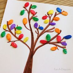 Use colorful pumpkin seeds to make fall tree art