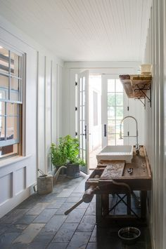 Love this workbench converted into a potting bench.  What an AWESOME reuse!  farmhouse entry by Donald Lococo Architects