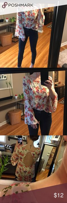 Floral shirt with open back Beautifully unique and perfect for spring/ summer. Floral design and light flowy blouse material. Open back with bell sleeves. Purchased from Vonmaur, size medium. No trades please. Haute Society Tops