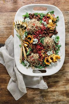 Roasted Delicata Squash & Rainbow Quinoa Salad with Pomegranate Seeds, Arugula, Candied Pecans & Herbed Goat Cheese