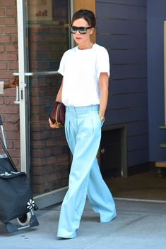 White tee outfit formula: Oversized Sunnies + White Tee + Wide Leg Pastel Pants. Seen here: Victoria Beckham.