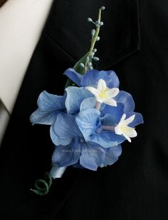 Lapel flowers for the Groom and the ushers to go with blue and white hydrangea bouquets