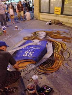 An artist chalks a woman with Kevin Durant's Oklahoma City Thunder NBA basketball jersey on the sidewalk at Live on the Plaza Friday in Oklahoma City June 8, 2012. Photo by Michael Kimball.