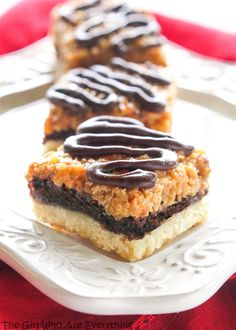Samoa Brownie Bars - A shortbread crust topped with a brownie layer and caramel coconut inspired by the girl scout cookie. from @GirlWhoAte