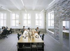 Oktavilla Graphic Design Agency (Stockholm, Sweden) - link has cool office spaces from around the world.    The Oktavilla Graphic Design office was designed by Elding Oscarson Architects. The office is located in an old textile manufacturing hall in Stockholm, Sweden.